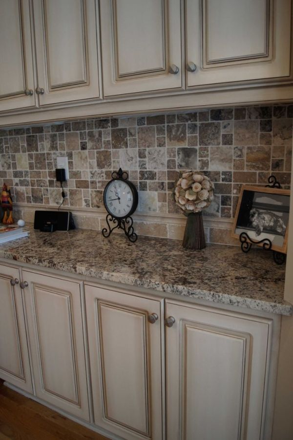 Cabinets refinished to a custom off white finis