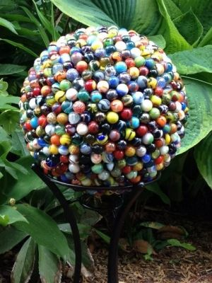 Garden sculpture recycled marbles and bowlin