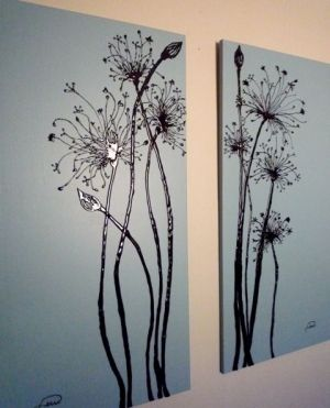 Hot glue fake flowers to a canvas and then pic