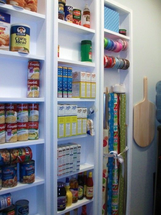Pantry shelves built in between the studs to ad
